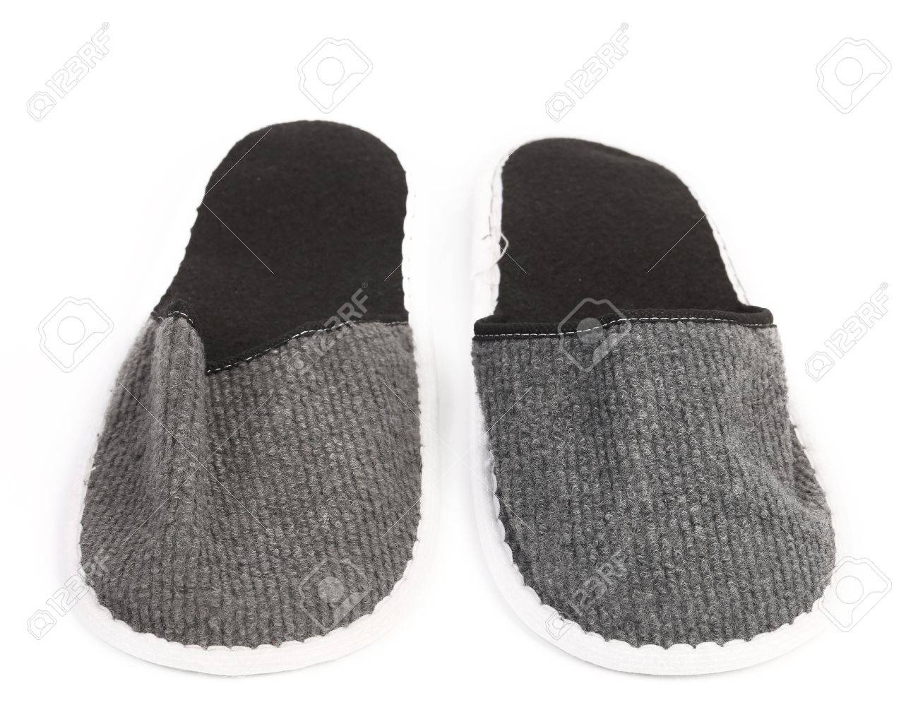 Pair of gray slippers on a white background. Close up. Stock Photo - 21866532