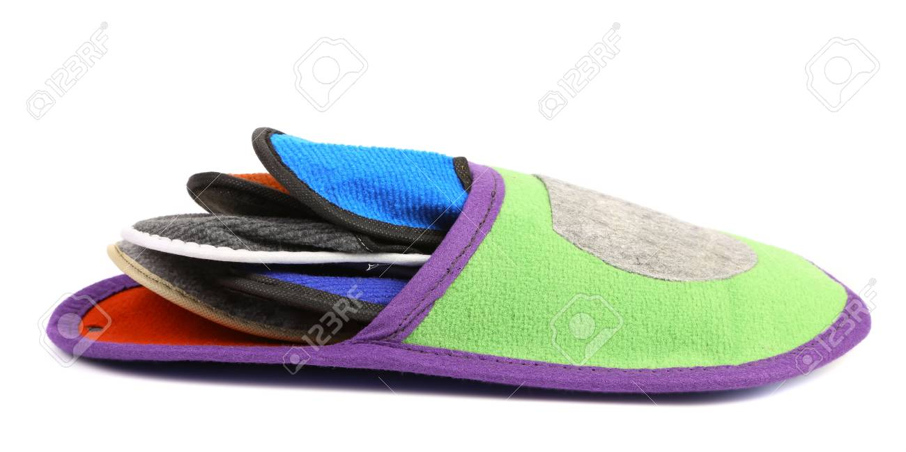 Colourful slippers into big slipper on a white background. Stock Photo - 21866559
