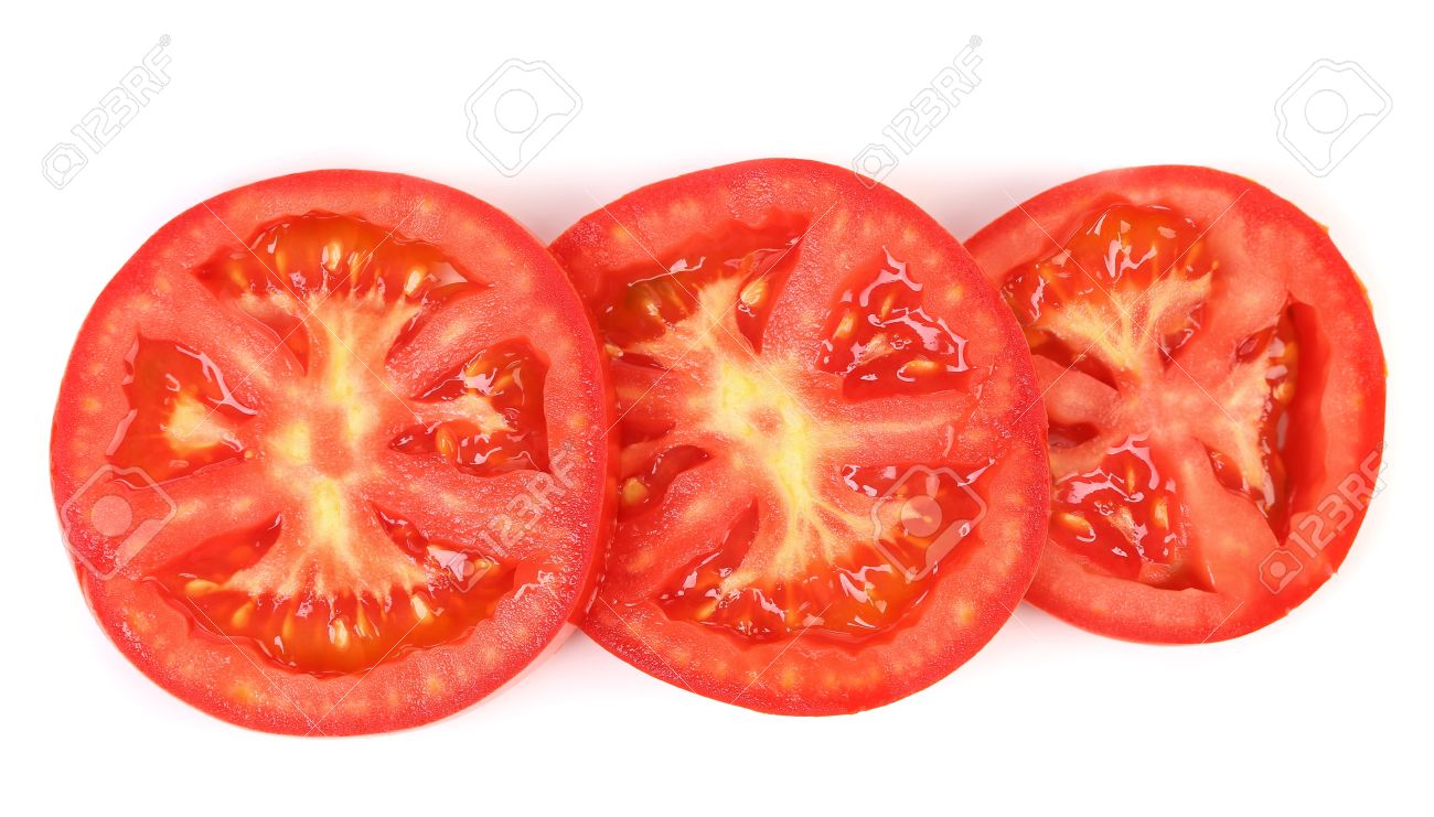 tomato slice isolated on white background close up stock photo