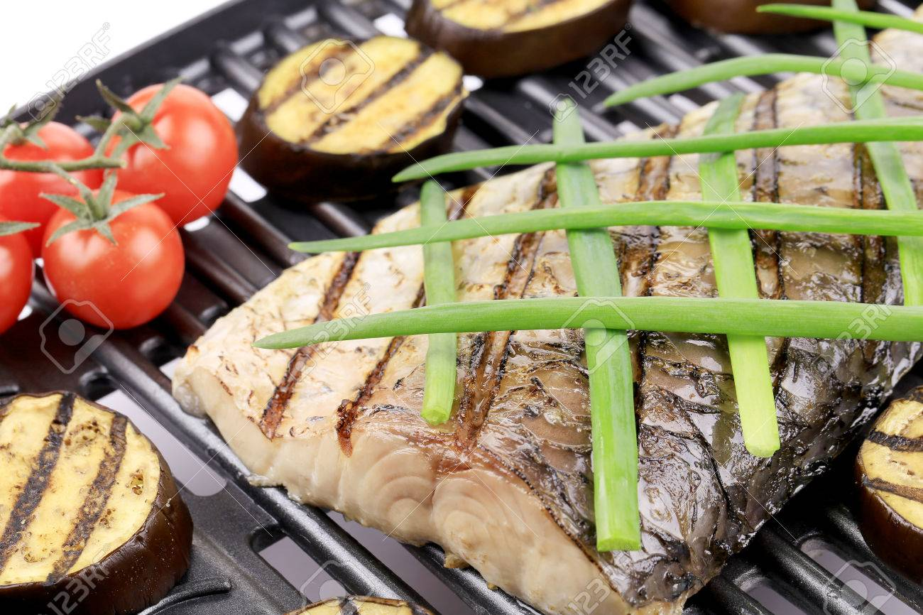 Grilled carp fillet on grill with egg plant. Whole background. Stock Photo - 25609233