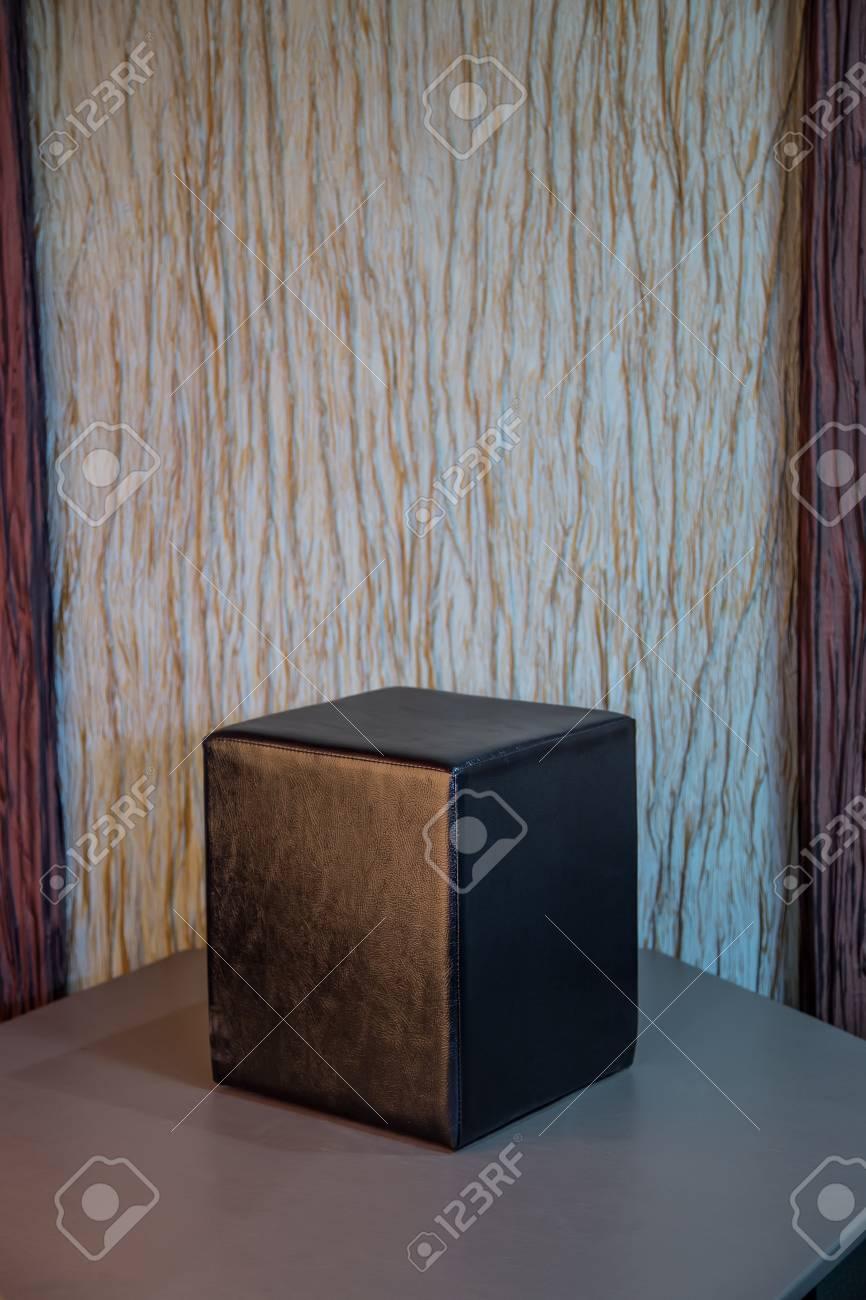 Stupendous Black Leather Cube Chair On Wallpaper Background Creativecarmelina Interior Chair Design Creativecarmelinacom