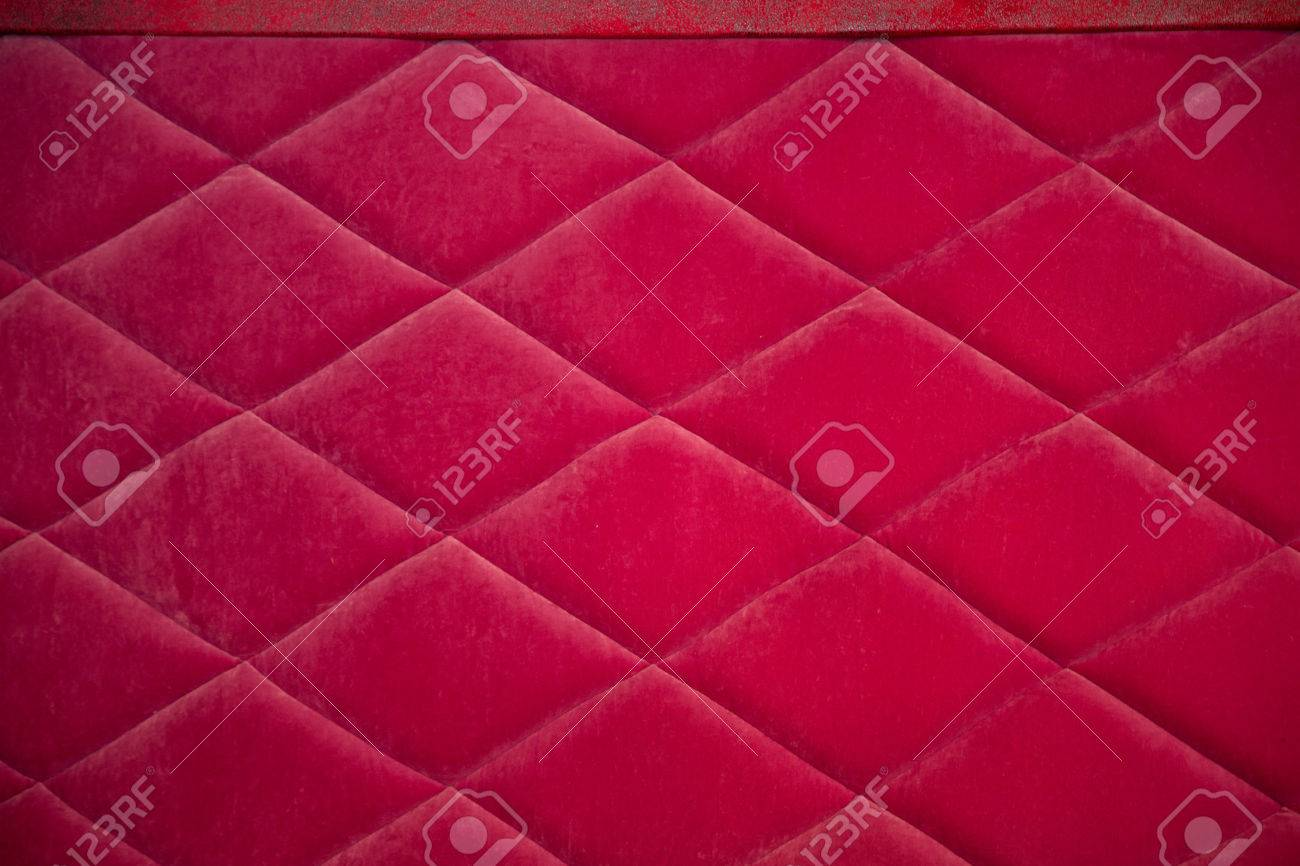 Red fabric texture with rhombuses, sofa upholstery