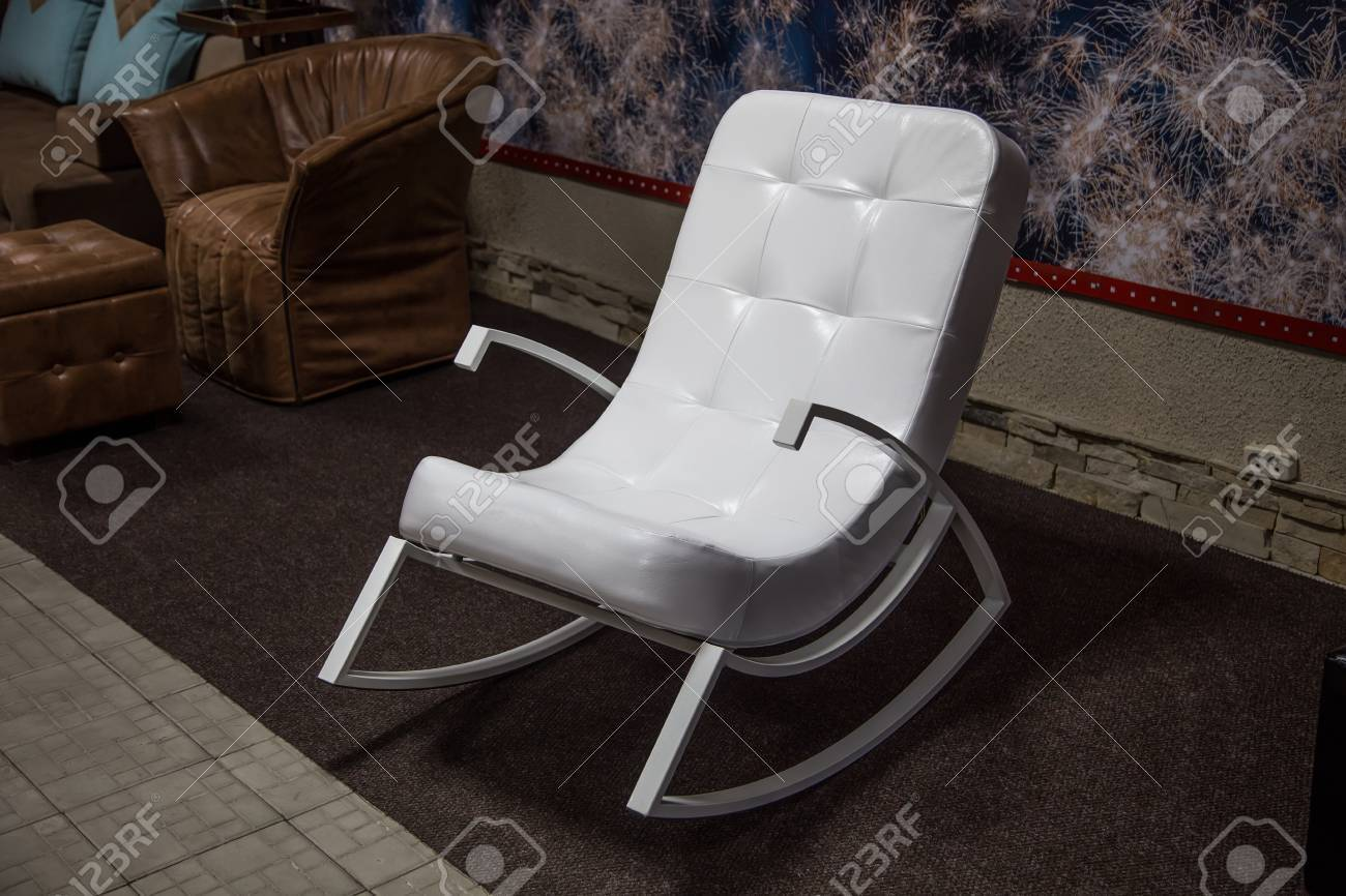Superb Modern White Leather Rocking Chair Staying In Showroom Bralicious Painted Fabric Chair Ideas Braliciousco