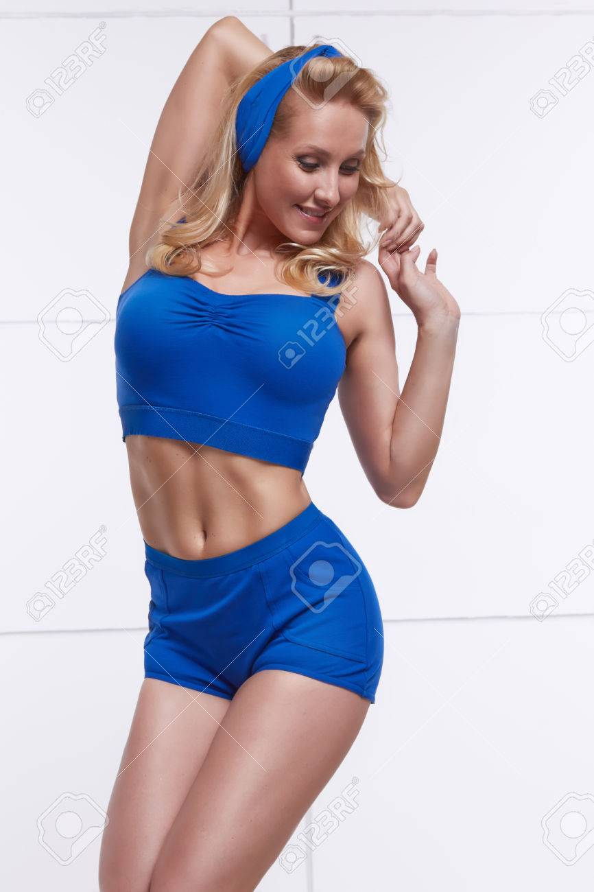 Young blonde dressed in style pinup tanned body fitness sport stock stock photo young blonde dressed in style pinup tanned body fitness sport thecheapjerseys Images