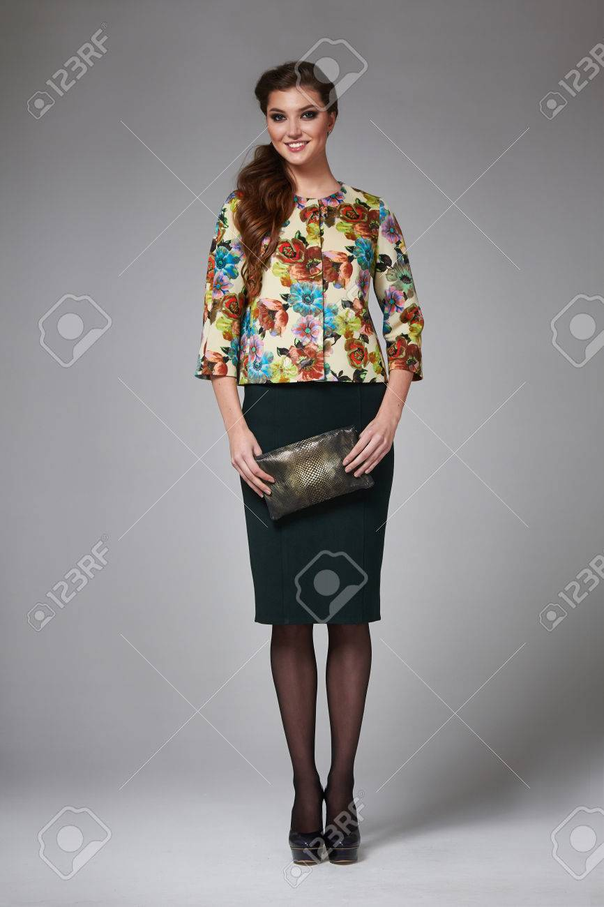 5f525f810a162d Beautiful young business woman with evening make-up wearing a skirt to the  knee and a silk blouse with lace long sleeves and high-heeled shoes and a  small ...