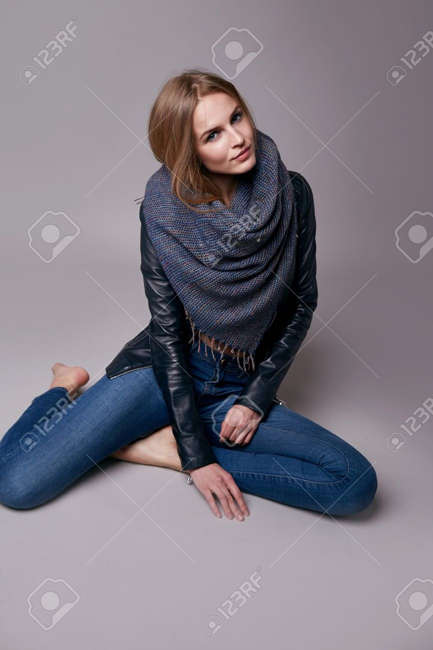 Beautiful young teen girl with long blonde hair with natural make-up  wearing jeans and