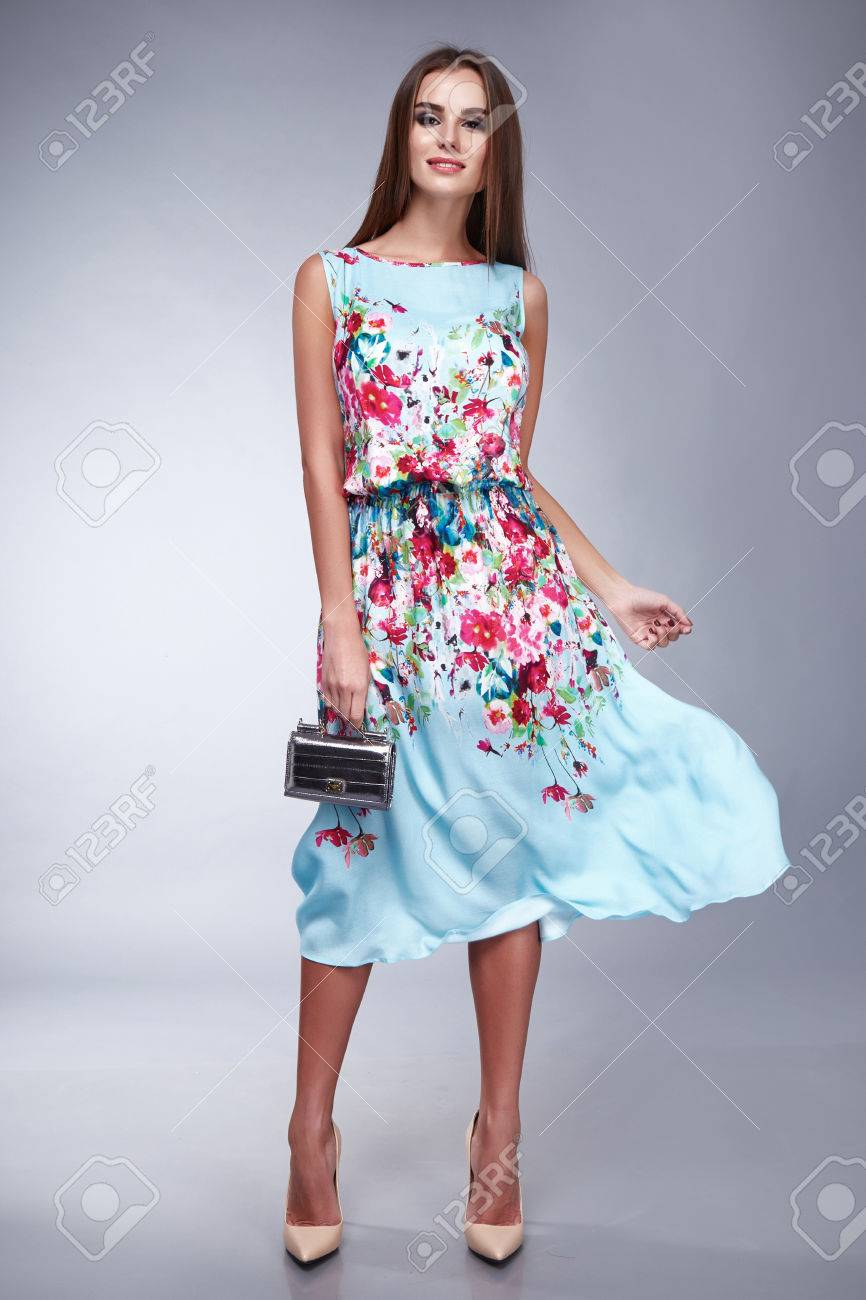 Beautiful young brunette girl woman lady dressed in a pale blue silk handbag and belt Accesories long dark hair, make-up and cosmetics, catalog of everyday and festive dress, style and fashion - 51801944