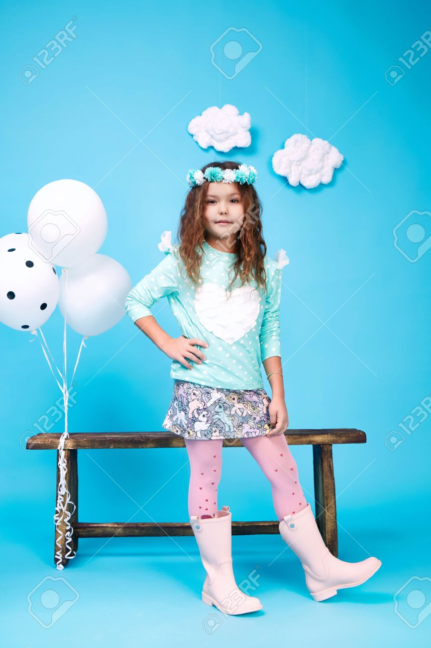 Small little beautiful pretty cute girl dark hair hat with flowers wear fashion style trend clothing dress skirt blouse shoe smile play with bench and balloons dance jump children kid happy daughter - 54432866
