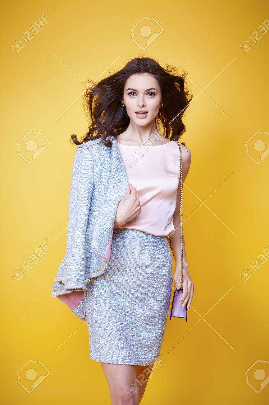 business woman in office clothes wear costume flax jacket and skirt light blue silk pink hold