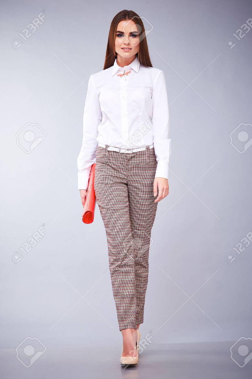 adcae43472704 Glamour fashion style beautiful woman sexy clothes white cotton blouse and  pants trendy accessory model pose