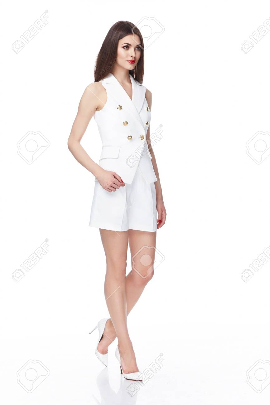 Stock Photo - Young beautiful female model in white dress on white background studio woman brunette hair makeup body shape clothes collection summer office ...