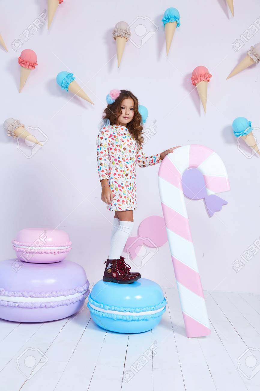 cb5893e6d Cute little baby girl fashion pretty model dark blonde curly lady hair  funny child birthday party fun children room candy bar sweet ice cream play  with toy ...