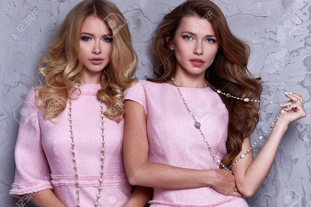 Portrait of two woman wear business style clothing for office casual meeting collection accessory pink silk suit glamour fashion model beauty face long brunette blond hair body shape cosmetic. - 72389648