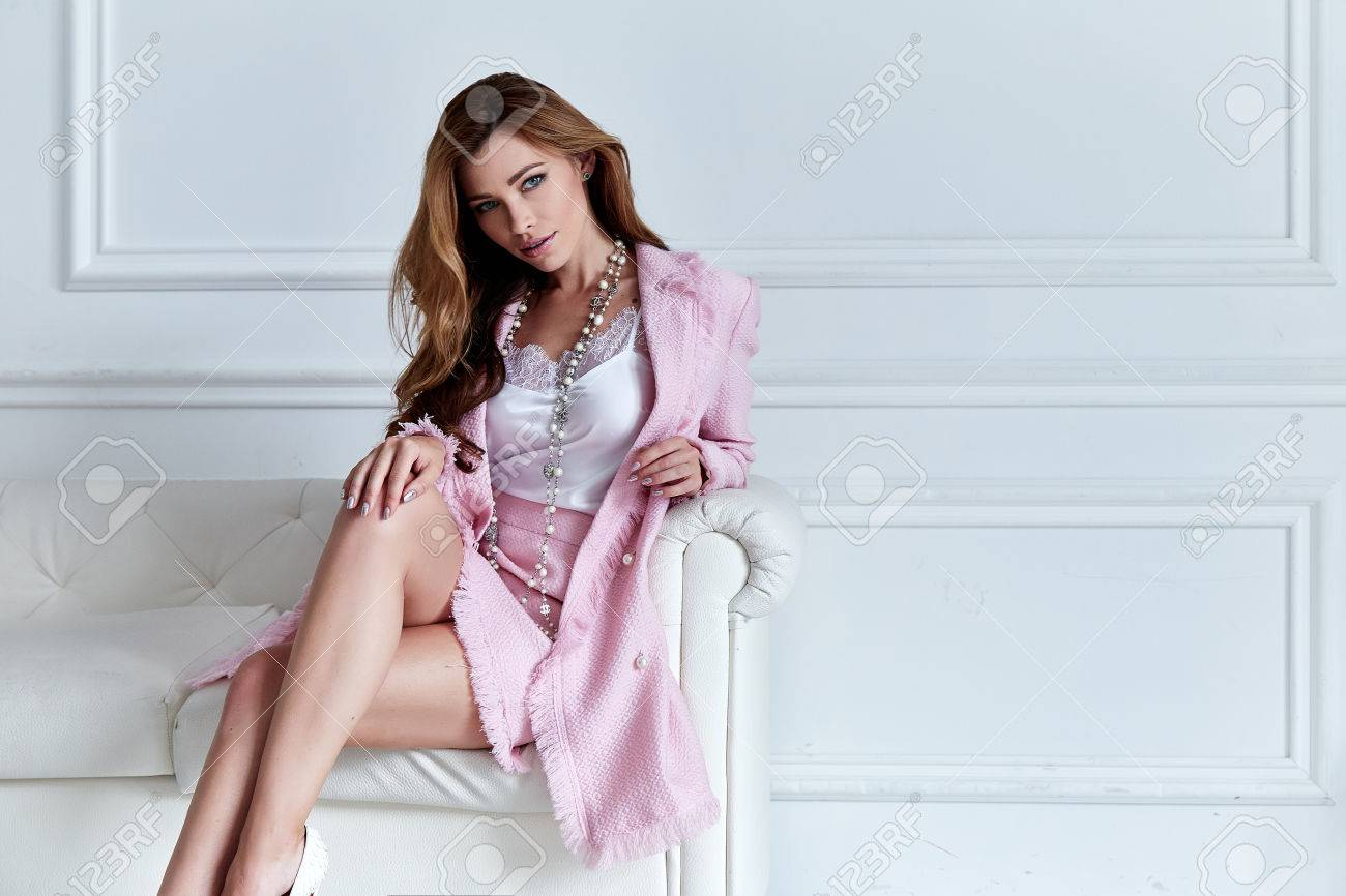 Beauty woman model wear stylish design trend clothing silk pink jacket suit skirt casual formal office style walk party long blond hair party businesswoman secretary diplomatic protocol room sofa. - 82697643