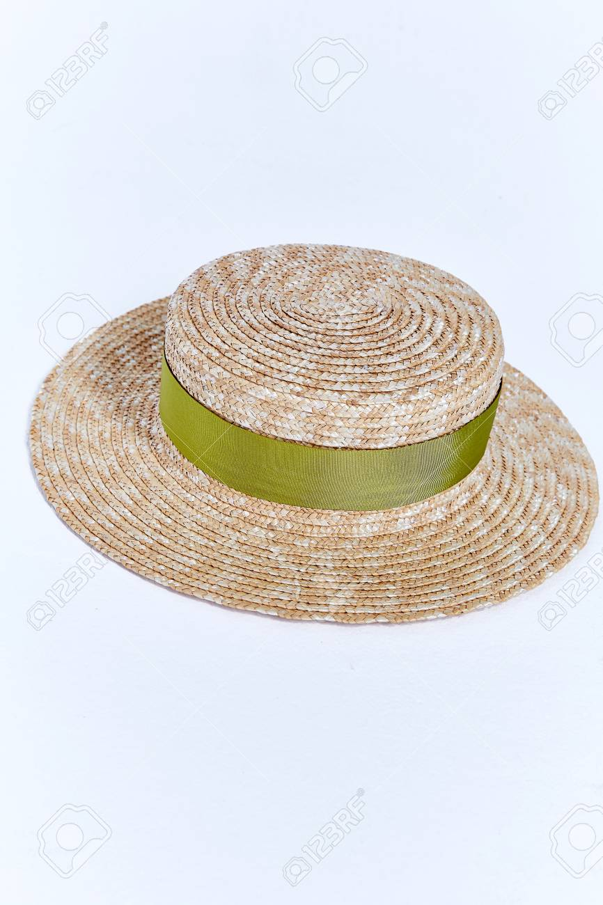 dac0cafc Stock Photo - Straw hat of light straw with velvet ribbon beautiful stylish  fashion accessory for summer resort on white background in studio.