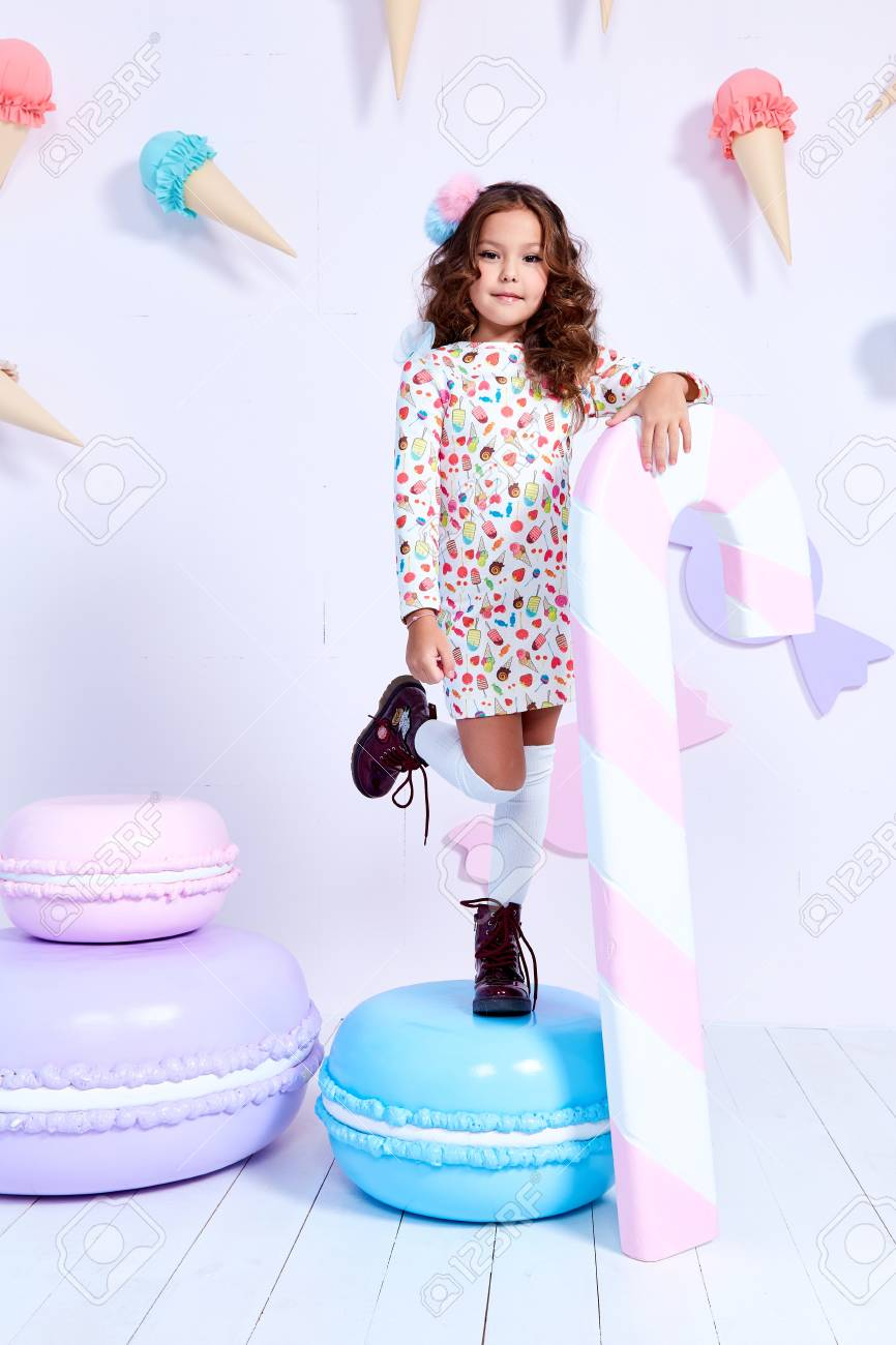 82167b6019fa Small little girl beautiful lady curly hair child wear funny clothes dress  socks boots cute face smile sweets baby shower party bar game room birthday  hold ...