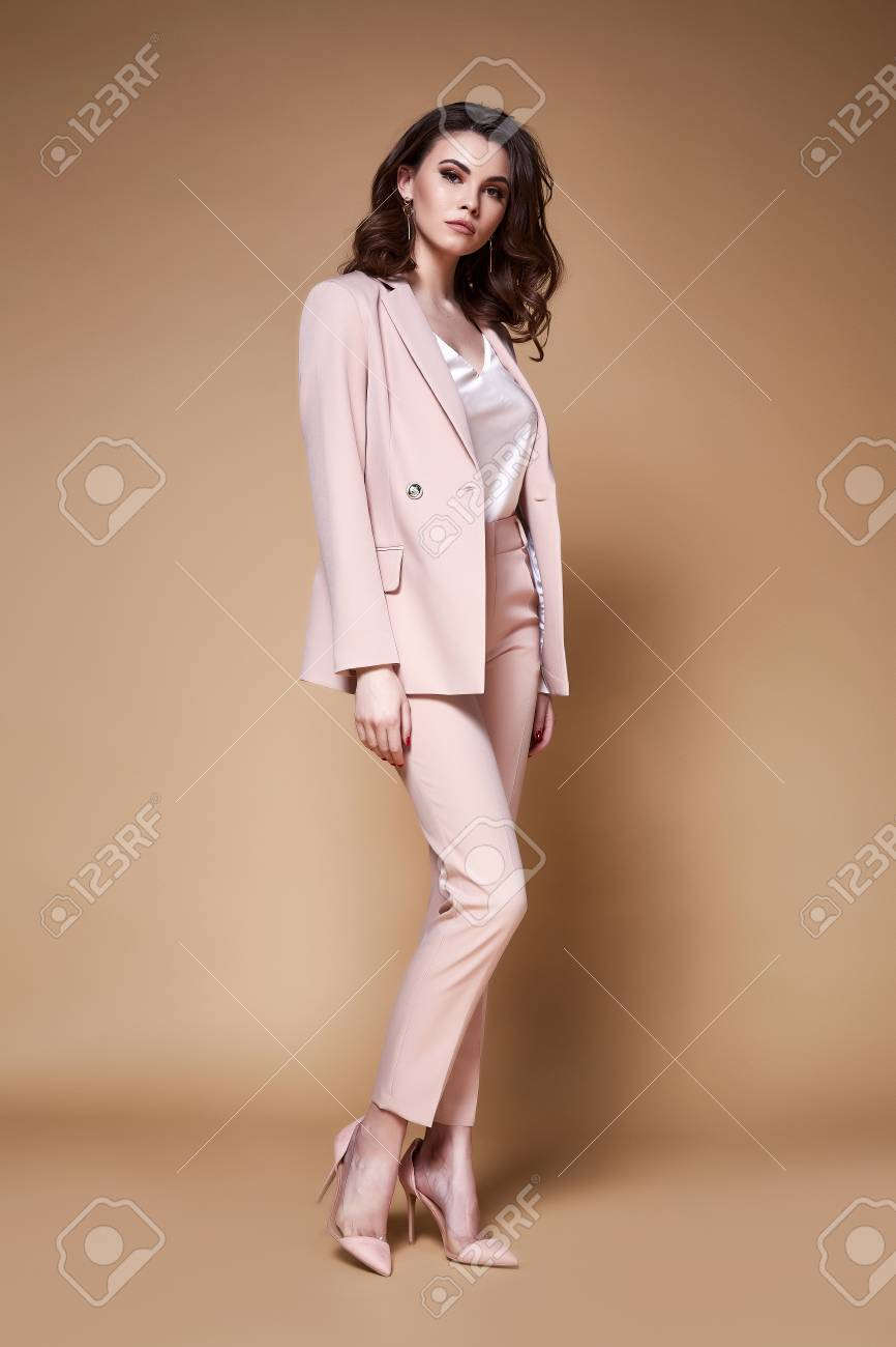 Sexy beautiful business woman lady boss CEO manager makeup long curly hair brunette wear clothes office dress code suit jacket pants uniform work or date catalog accessory jewelry elegant style. - 100852858