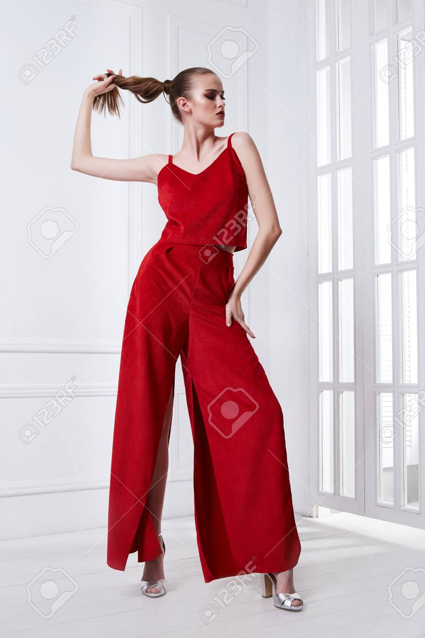 Beautiful sexy young business woman brunette hair with evening makeup wearing red dress suit blouse and