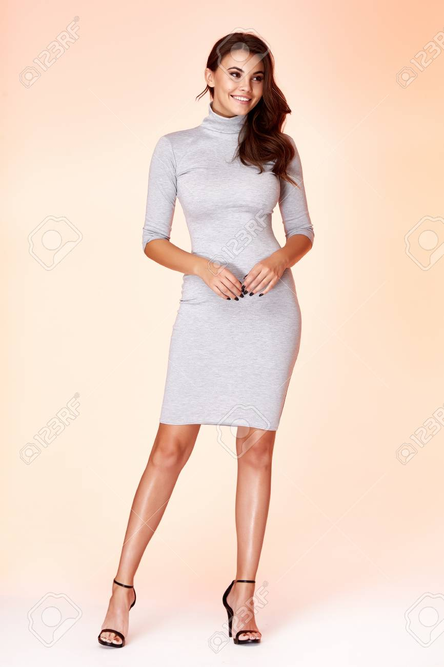 Beauty woman model wear stylish design trend clothing natural organic wool cotton grey dress casual formal office style for work meeting walk party brunette hair makeup. - 109886788