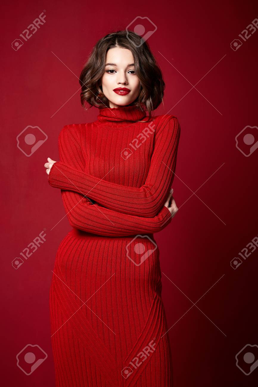 Beautiful pretty woman red lipstick jewelry earrings brunette hair cosmetic makeup fashion wear clothes style beauty salon happy party style Valentine's red background accessory brunette. - 113790096