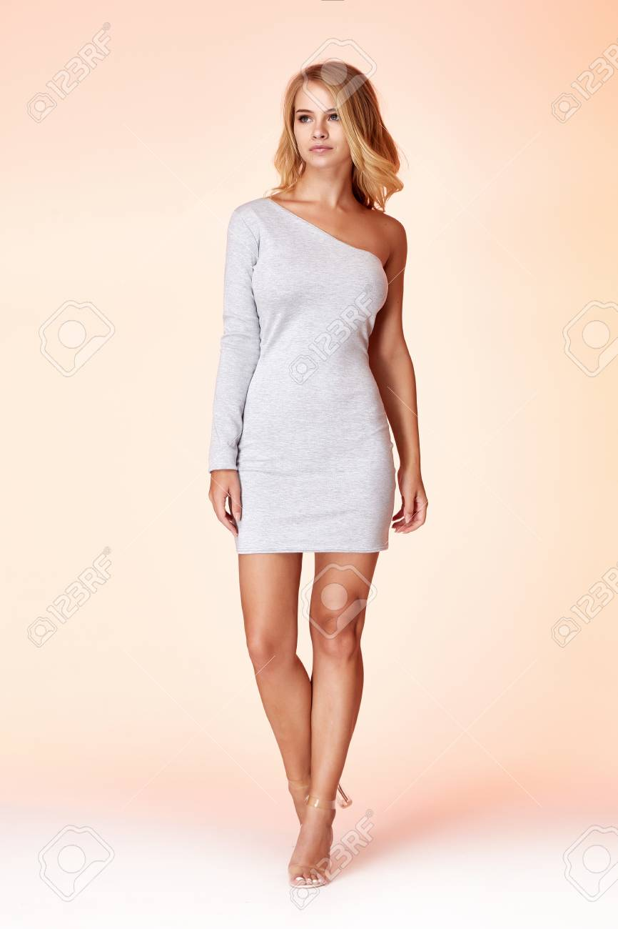 Beauty woman model wear stylish design trend clothing natural organic wool cotton grey dress casual formal office style for work meeting walk party brunette hair makeup. - 117672496