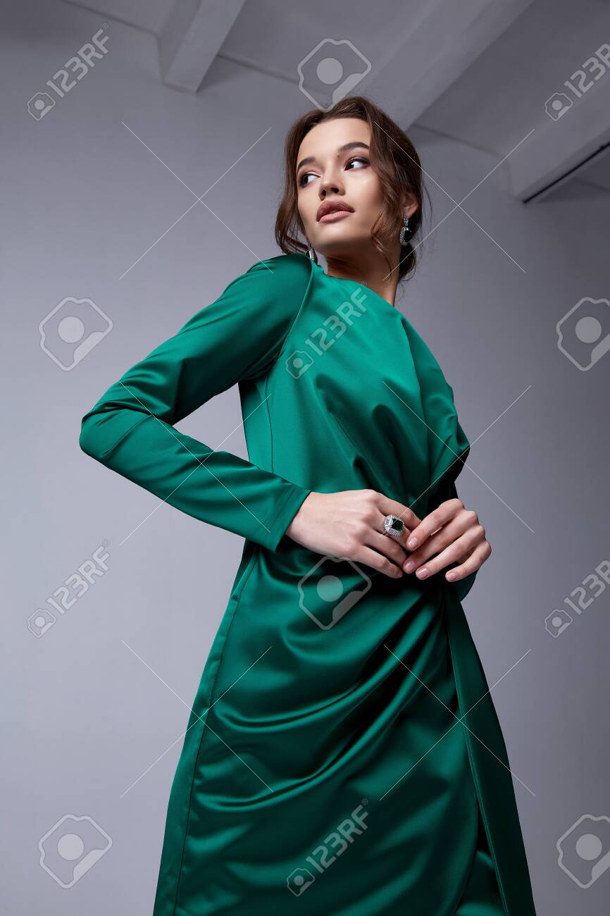 Beautiful young woman thin slim figure evening makeup fashionable stylish dress clothing collection, brunette, green silk bows holiday party birthday New Year Christmas Valentine's Day. - 137973140