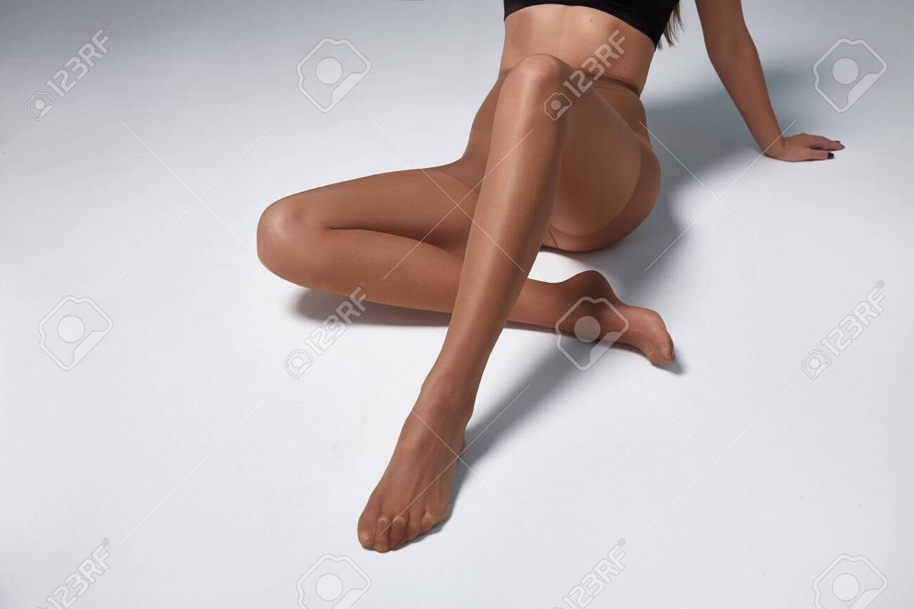 Part Of Woman Body Perfect Shape Legs Feet Skin Tan Wear Stockings Stock Photo Picture And Royalty Free Image Image 142474174