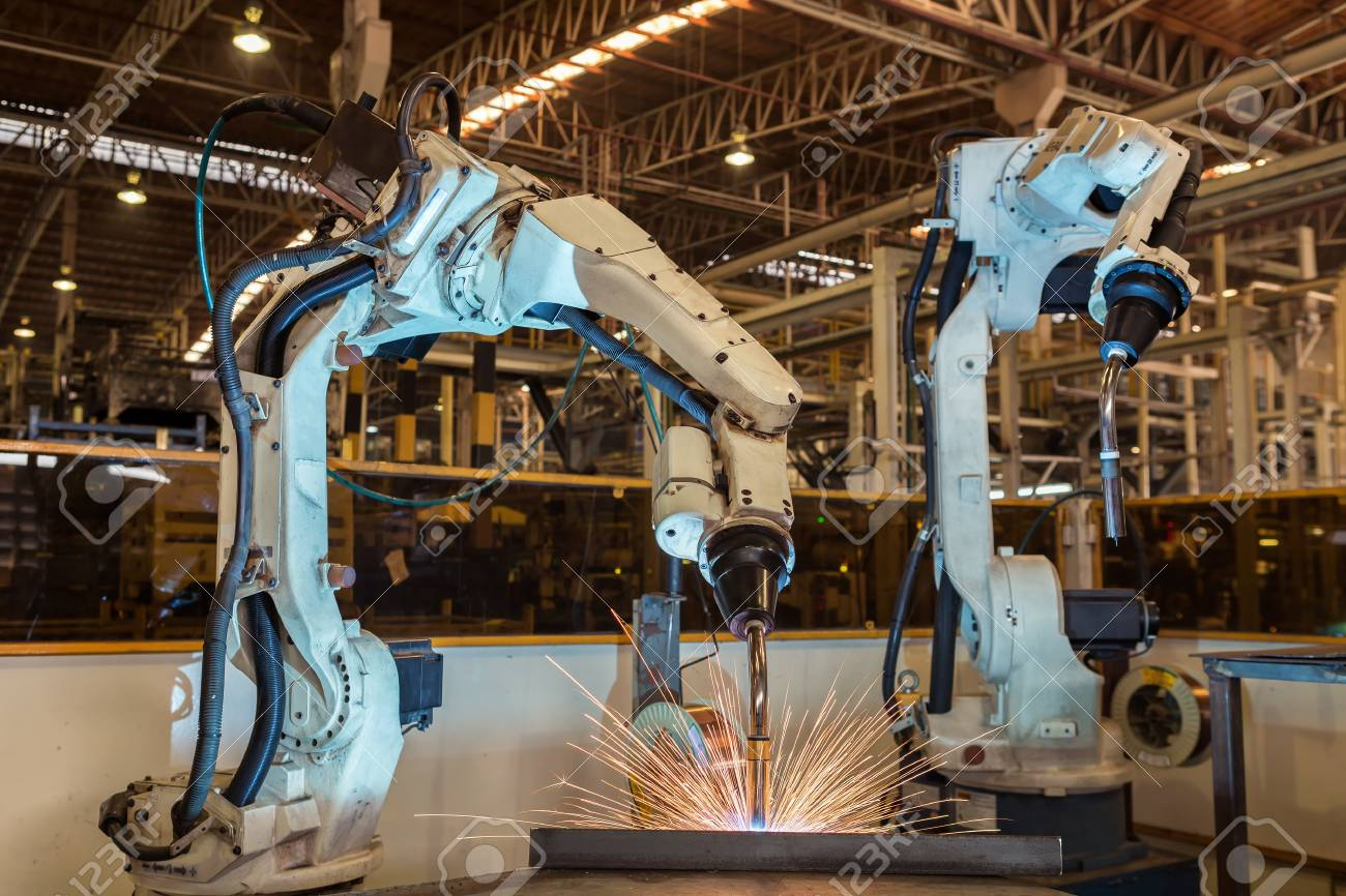 Industrial robot are test run new program in automotive assembly factory - 81364335