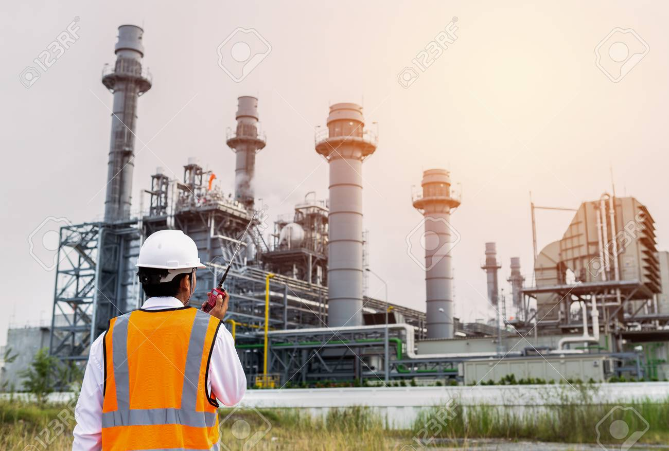 Engineer is checking around gas turbine electric power plant