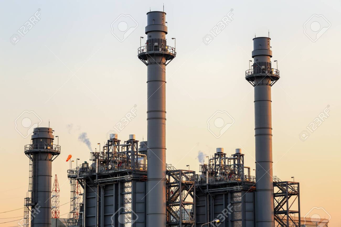 Gas turbine electrical power plant at dusk with twilight support all factory in industrial Estate - 134065783