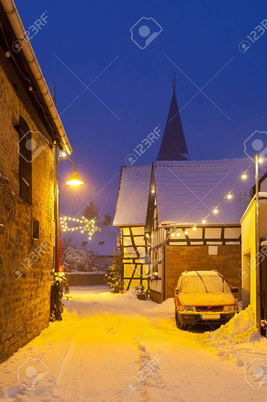 An Old Street With Half-timbered Houses And Christmas Lights.. Stock ...