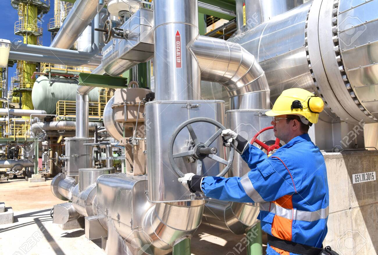 Workers in an industrial plant for the production and processing of crude oil - 149714205