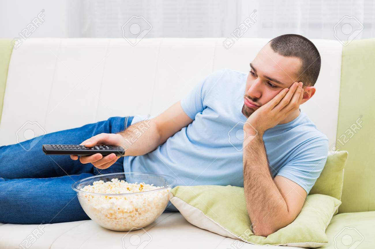 Man Changing Channels And Feeling Bored At His Home. Stock Photo ...