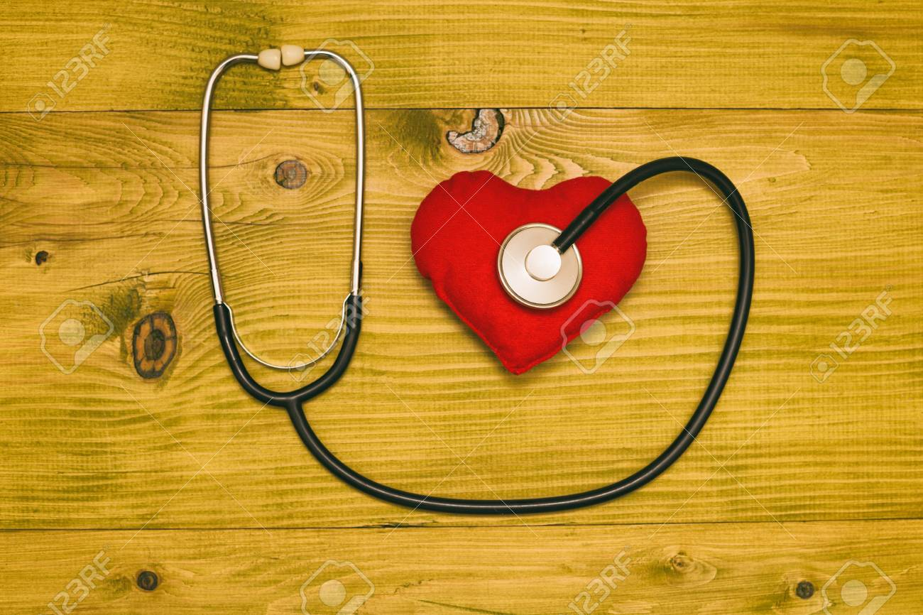 Image of fruit,stethoscope and heart shape on wooden table.Toned photo. - 121351688