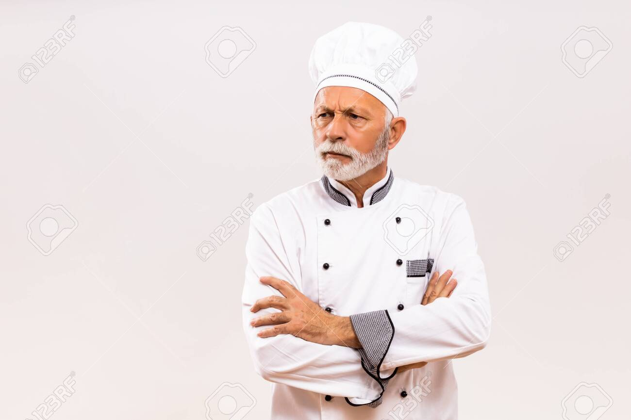 Portrait of angry senior chef on gray background. - 145970209
