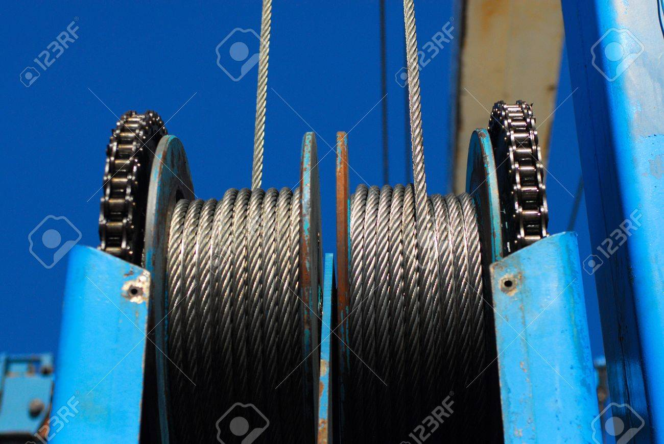 Steel Cable Pulleys Against Clear Blue Sky. Stock Photo, Picture ...