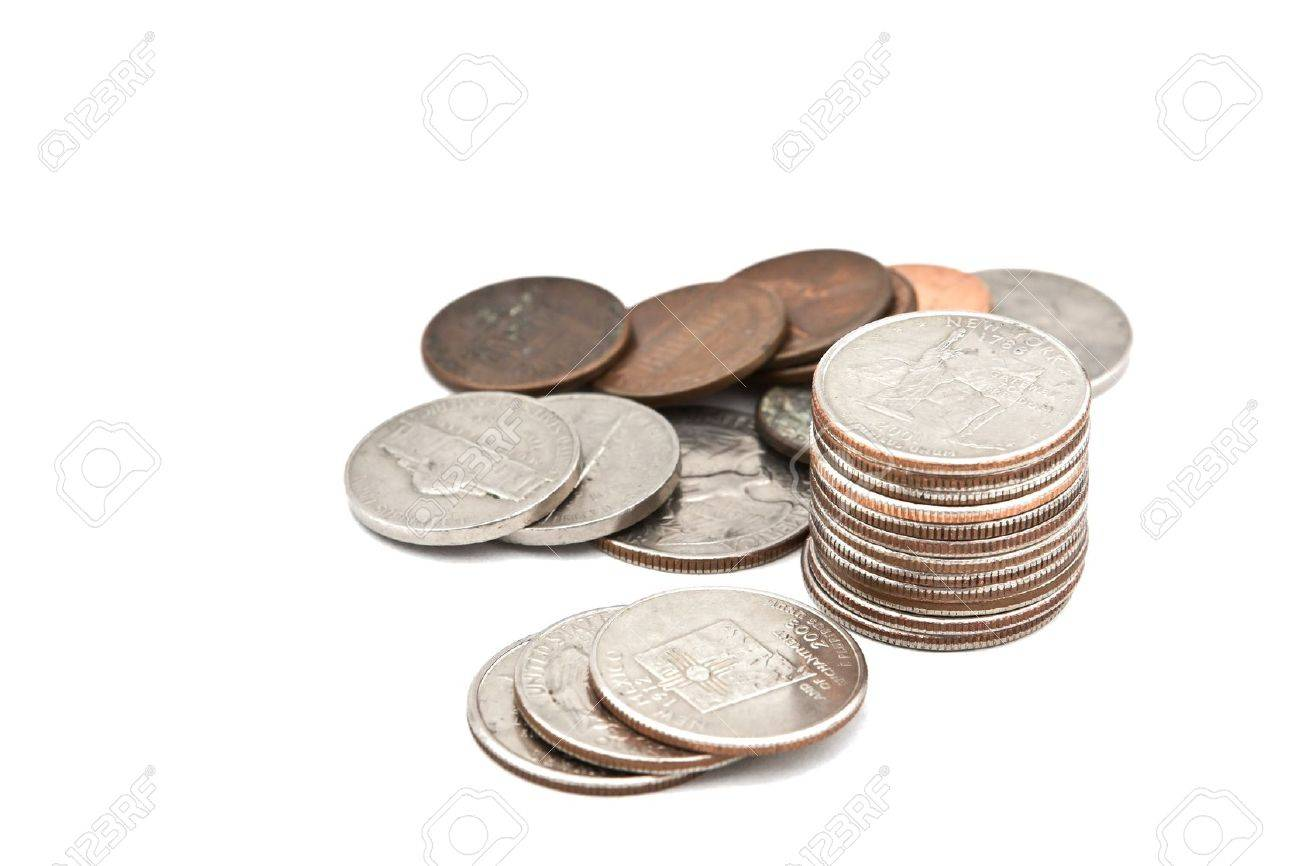 Coins and loose change on a white background stock photo 12001961
