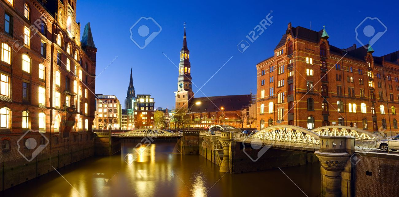 Warehouse district Speicherstadt of Hamburg at night with view towards the city center - 12420101
