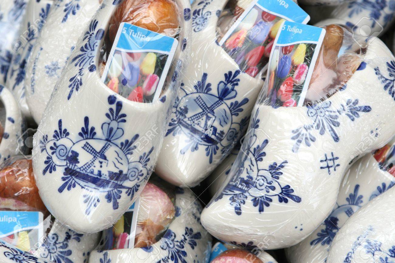 wooden shoes and tulip bulbs from holland stock photo picture and