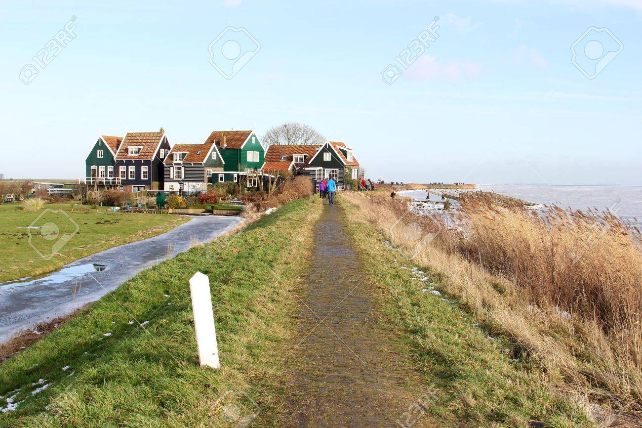 A dike leads to the small village Marken near Amsterdam Stock Photo - 17564431