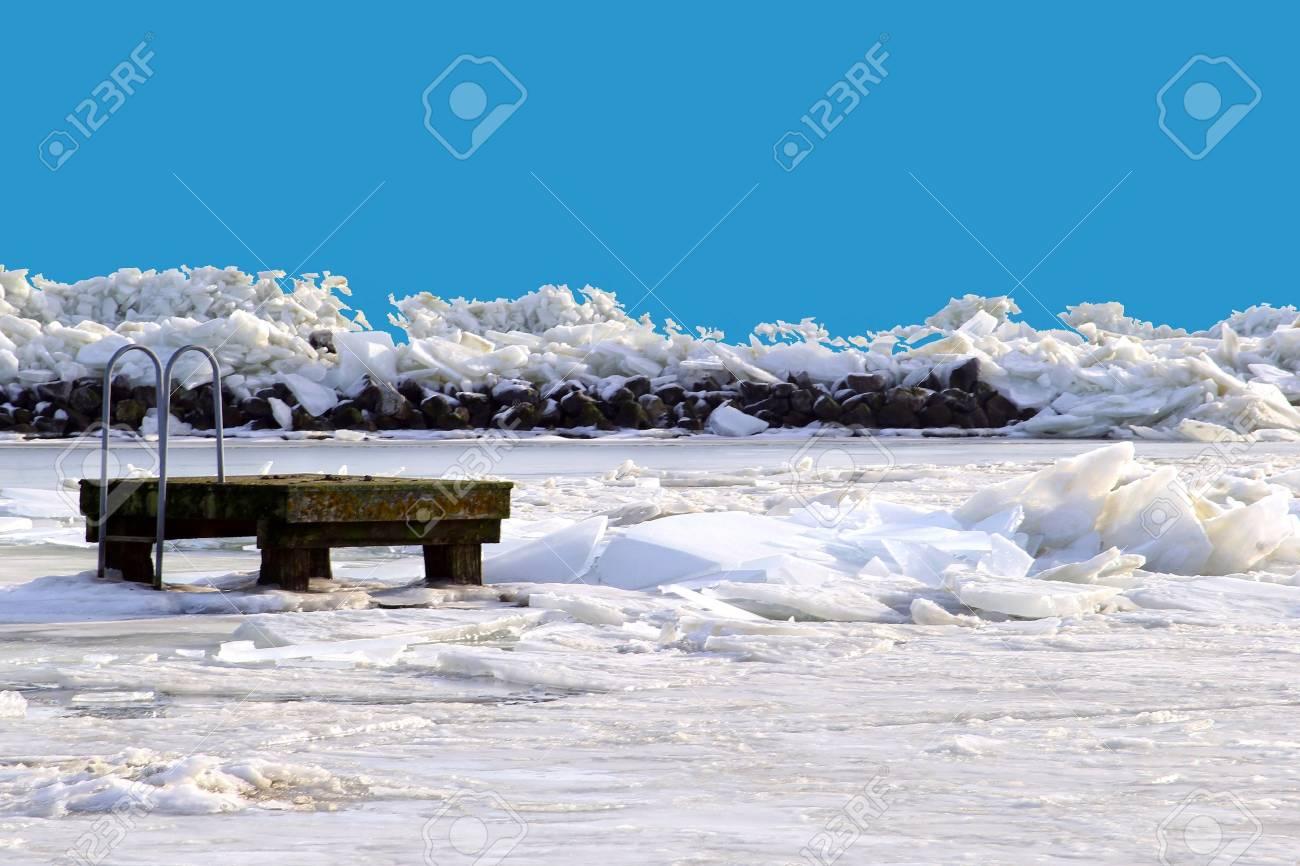 Pier in a frozen IJsselmeer near Amsterdam in Holland Stock Photo - 17687932