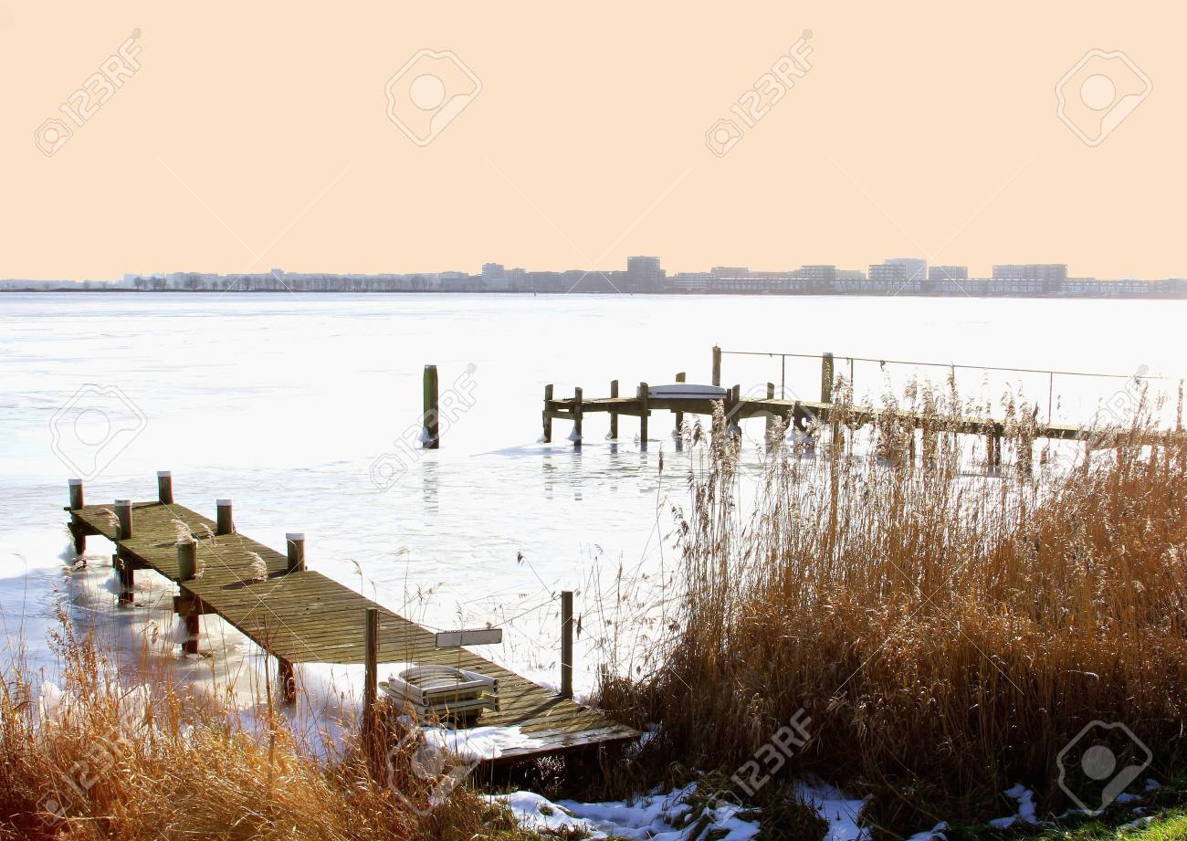 View from a frozen IJsselmeer at the skyline of Amsterdam Stock Photo - 17687934