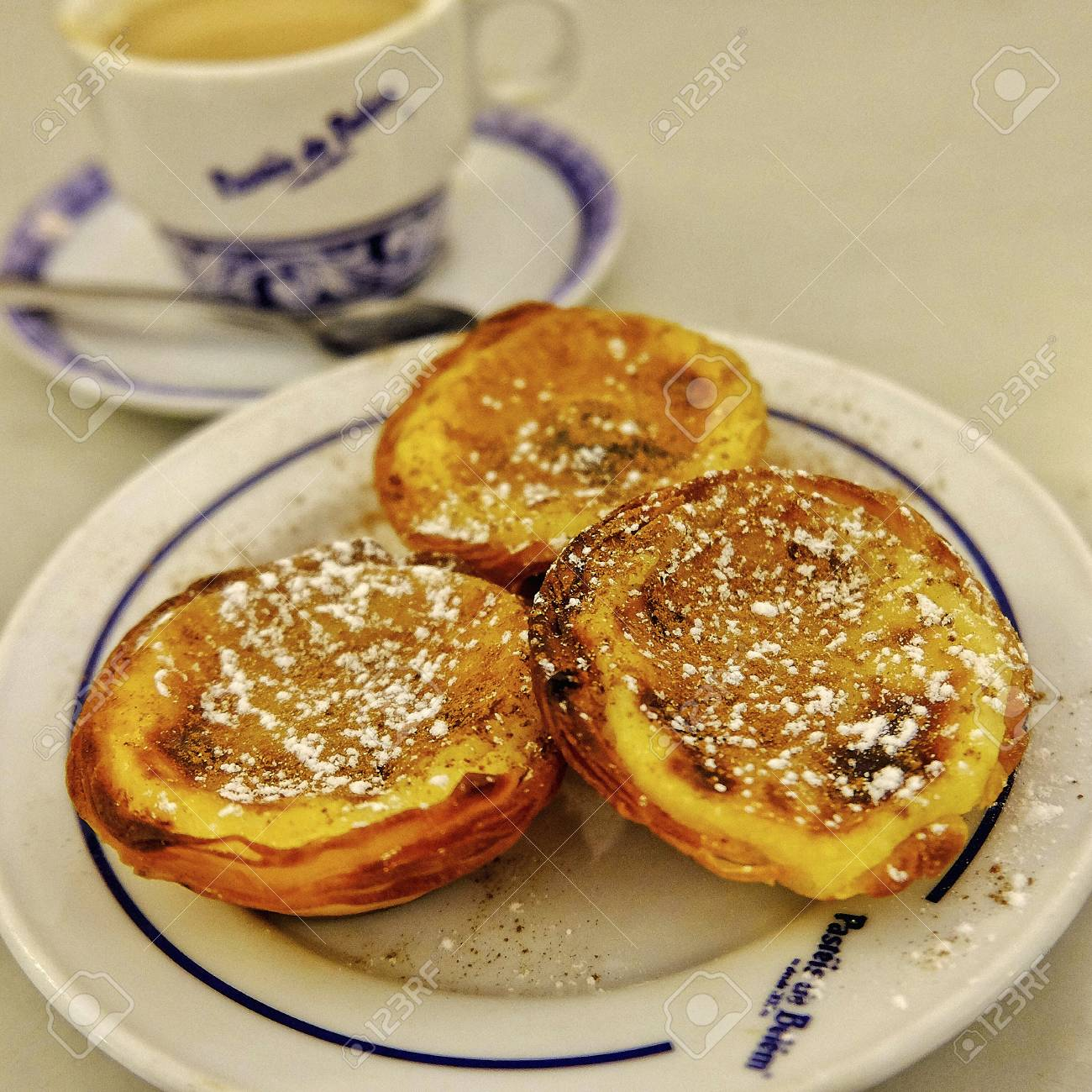 Close Up Of Traditional Portuguese Pasteis De Nata And Coffee