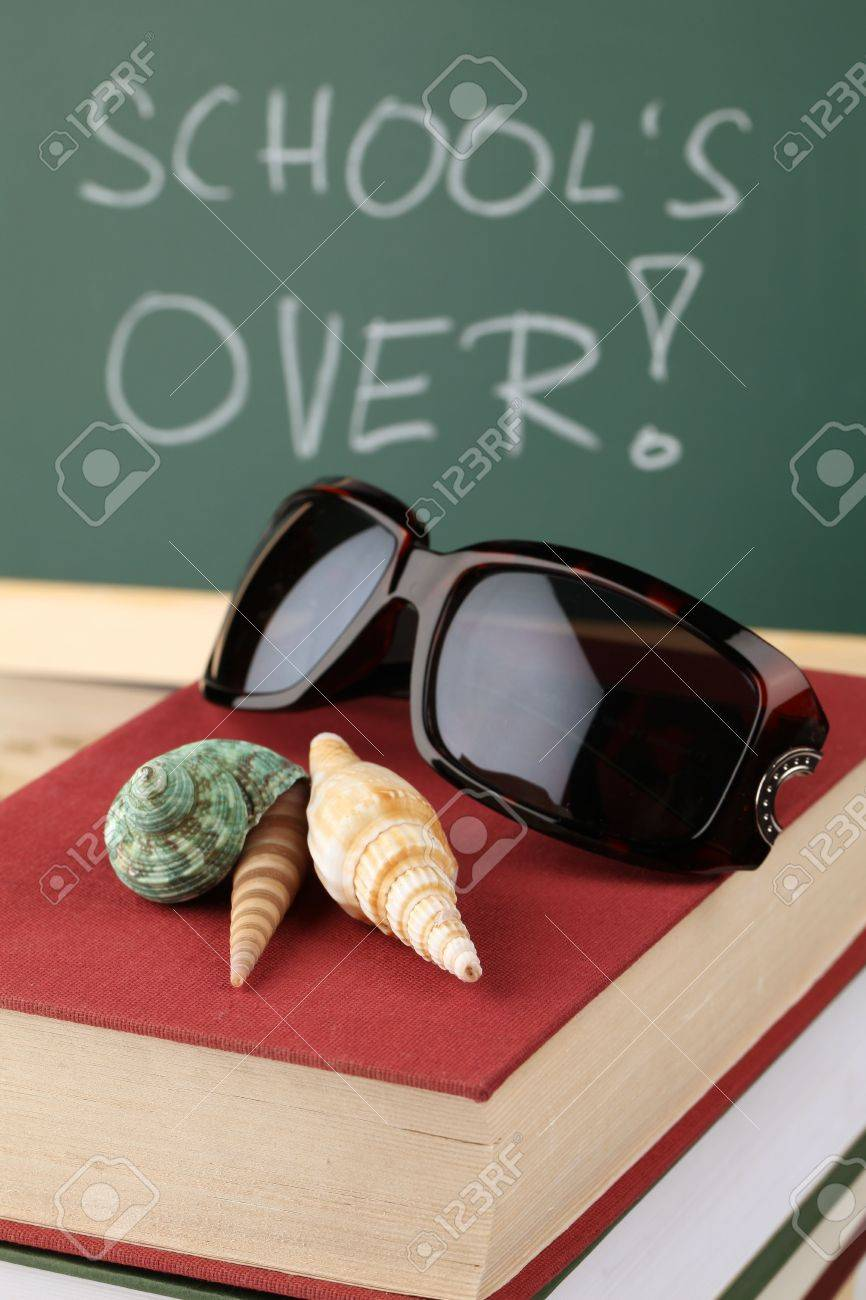 Sea shells and sunglasses on a pile of books and a chalkboard in background with text: School is over Stock Photo - 6878582