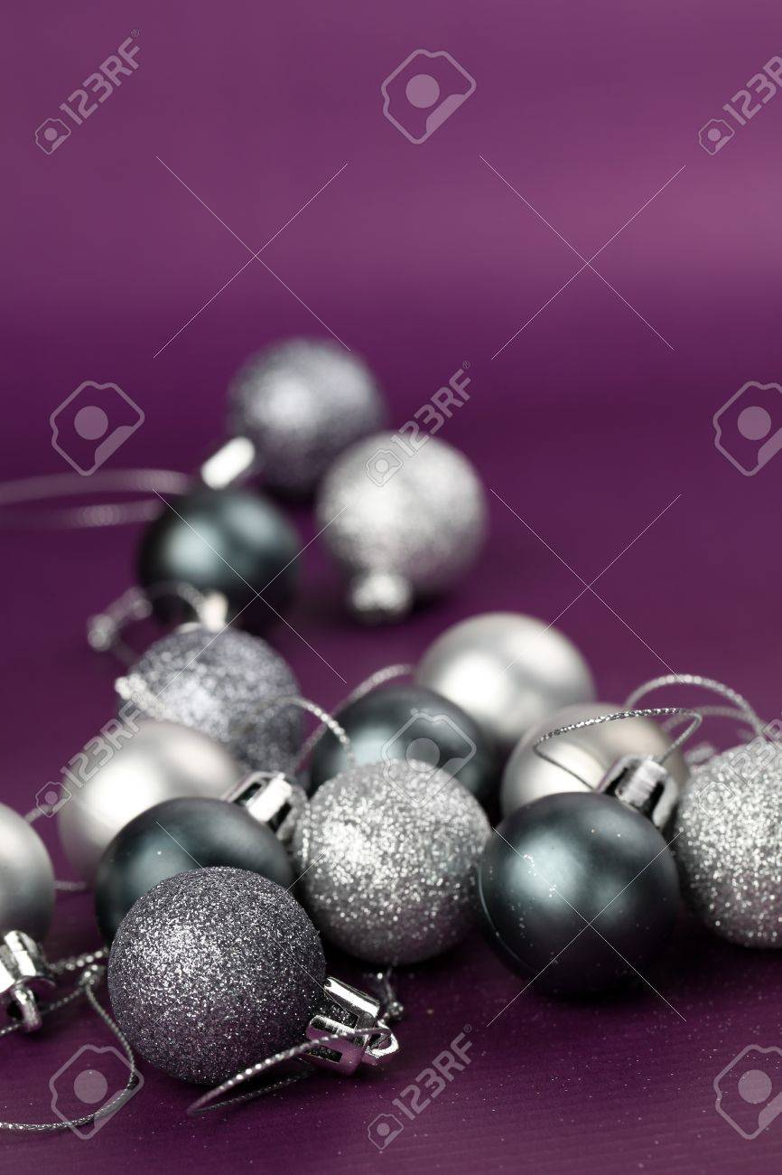 Silver Christmas ornaments on purple background. Copy space Stock Photo - 7387127