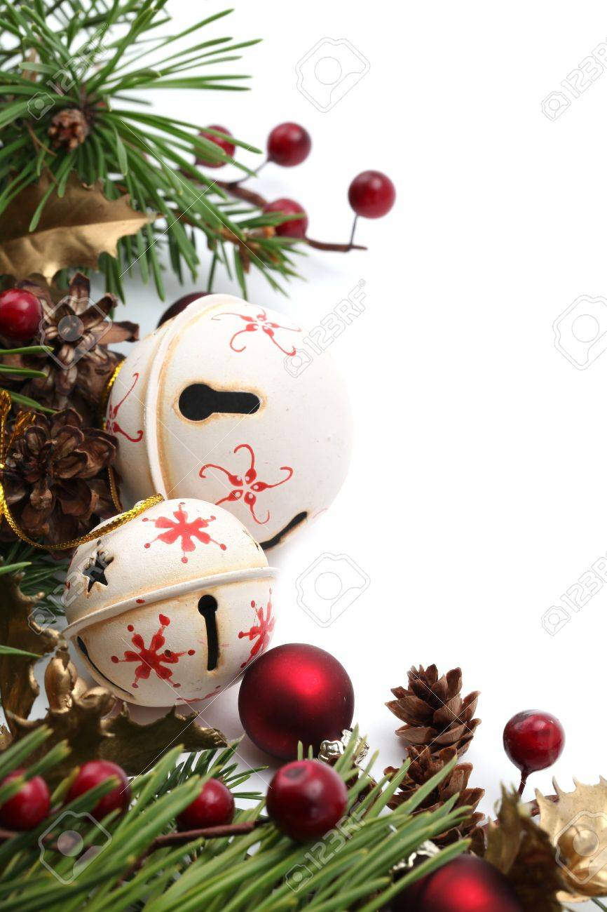 Christmas Border With Jingle Bells And Other Christmas Ornaments And  Decorations Isolated On White Shallow