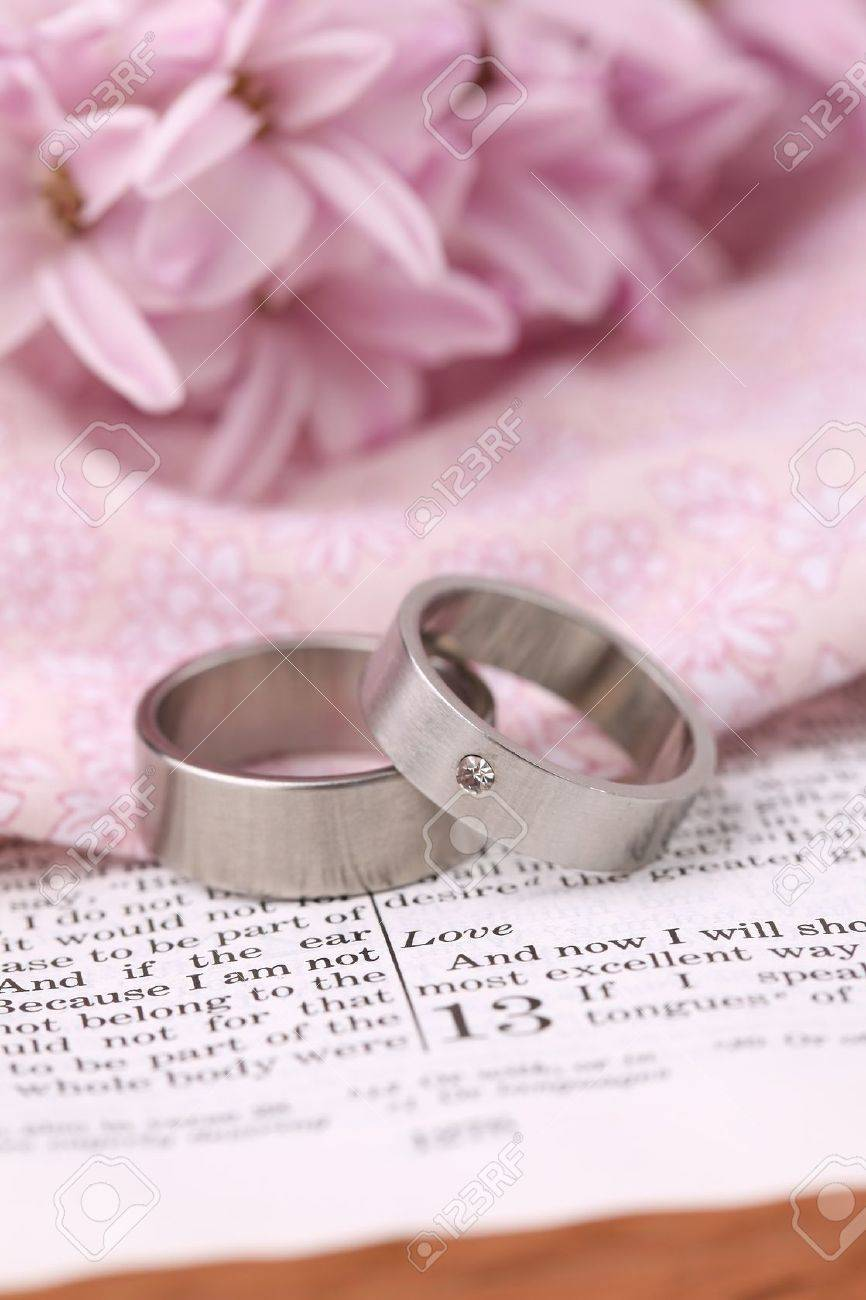 Titanium Wedding Rings On The Bible Open To 1st Corinthians 13 ...