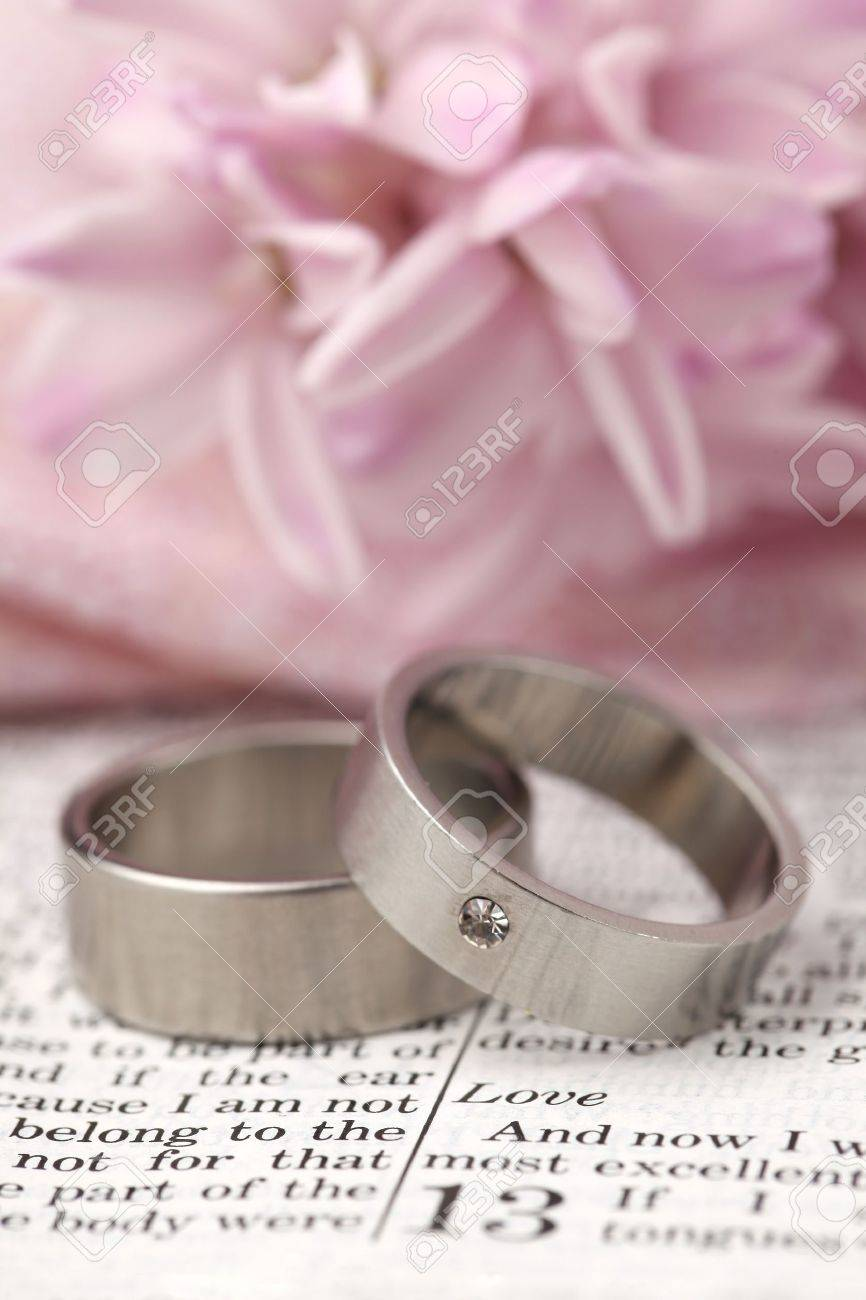 Titanium Wedding Rings On The Bible Open To 1st Corinthians 13 ...