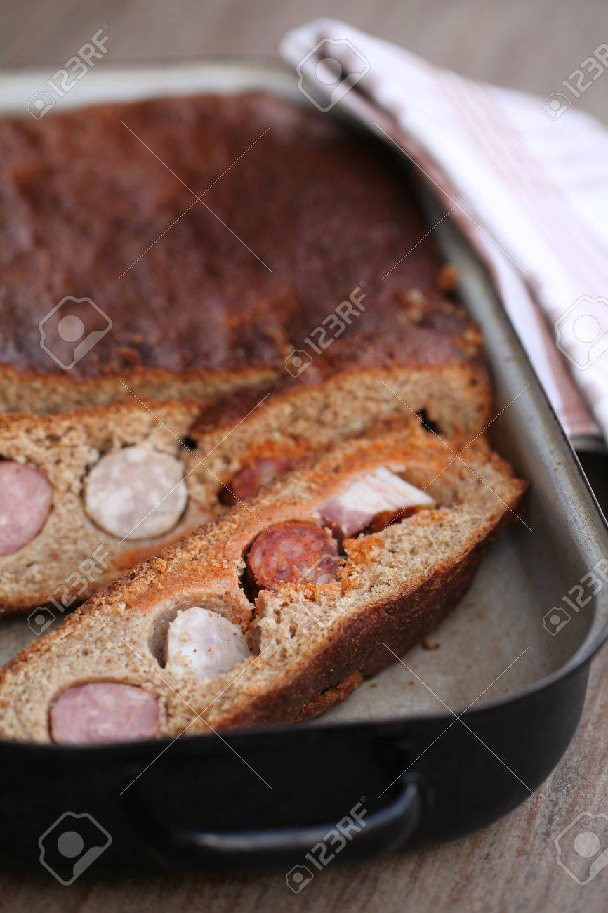 Easter semolina bread with sausages, bacon and smoked meat called szoldra (showdra) - traditional Easter food in Silesia, north-eastern part of the Czech Republic Stock Photo - 8771933