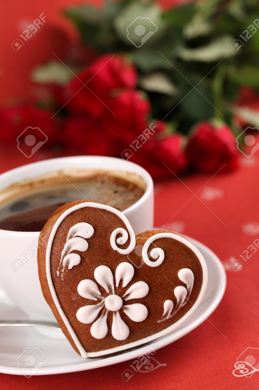 Gingerbread heart with coffee and red roses on red background. Shallow dof Stock Photo - 8771931